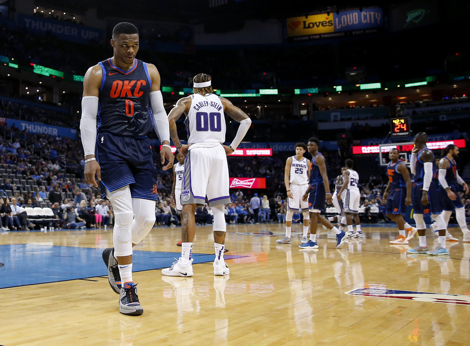 Photo - Oklahoma City's Russell Westbrook (0) walks off the court  late in an NBA basketball game between the Oklahoma City Thunder and the Sacramento Kings at Chesapeake Energy Arena in Oklahoma City, Sunday, Oct. 21, 2018. Photo by Bryan Terry, The Oklahoman