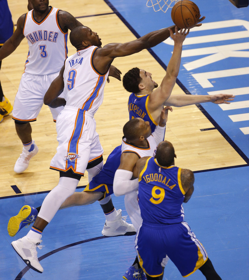 Photo - Oklahoma City's Serge Ibaka (9) defends Golden State's Klay Thompson (11) during Game 6 of the Western Conference finals in the NBA playoffs between the Oklahoma City Thunder and the Golden State Warriors at Chesapeake Energy Arena in Oklahoma City, Saturday, May 28, 2016. Photo by Bryan Terry, The Oklahoman