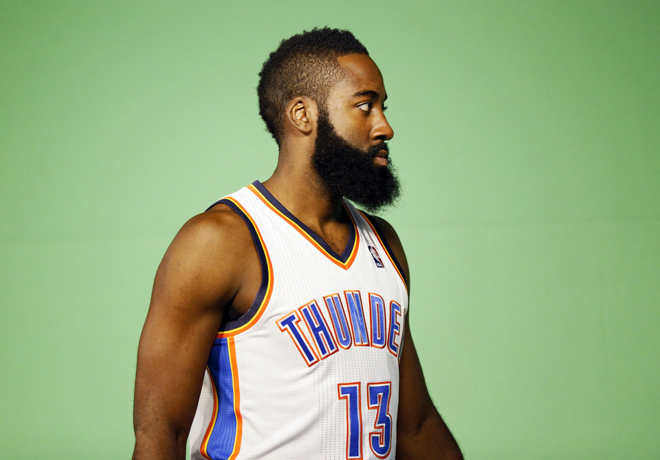Photo - James Harden poses on a green screen for use on the arena video scoreboard during media day for the Oklahoma City Thunder NBA basketball team at the Thunder Events Center in Oklahoma City, Monday, Oct. 1, 2012.  Photo by Nate Billings, The Oklahoman