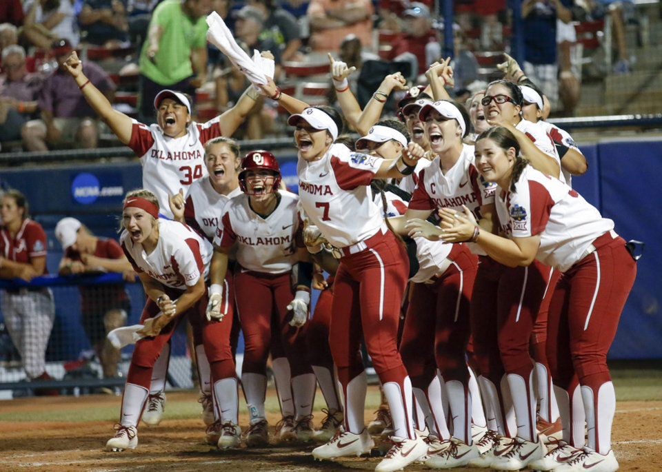 Photo - The Sooners wait at home plate for OU's Jocelyn Alo (78), not pictured, after she hit a two-run home run in the fifth inning during the if necessary NCAA softball game in the Women's College World Series between Oklahoma and Alabama at USA Softball Hall of Fame Stadium in Oklahoma City, Sunday night, June 2, 2019. [Sarah Phipps/The Oklahoman]