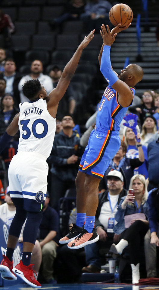 Photo - Oklahoma City's Chris Paul (3) shoots over Minnesota's Kelan Martin (30) during an NBA basketball game between the Minnesota Timberwolves and the Oklahoma City Thunder at Chesapeake Energy Arena in Oklahoma City, Friday, Dec. 6, 2019. Oklahoma City won 139-127 in overtime. [Nate Billings/The Oklahoman]