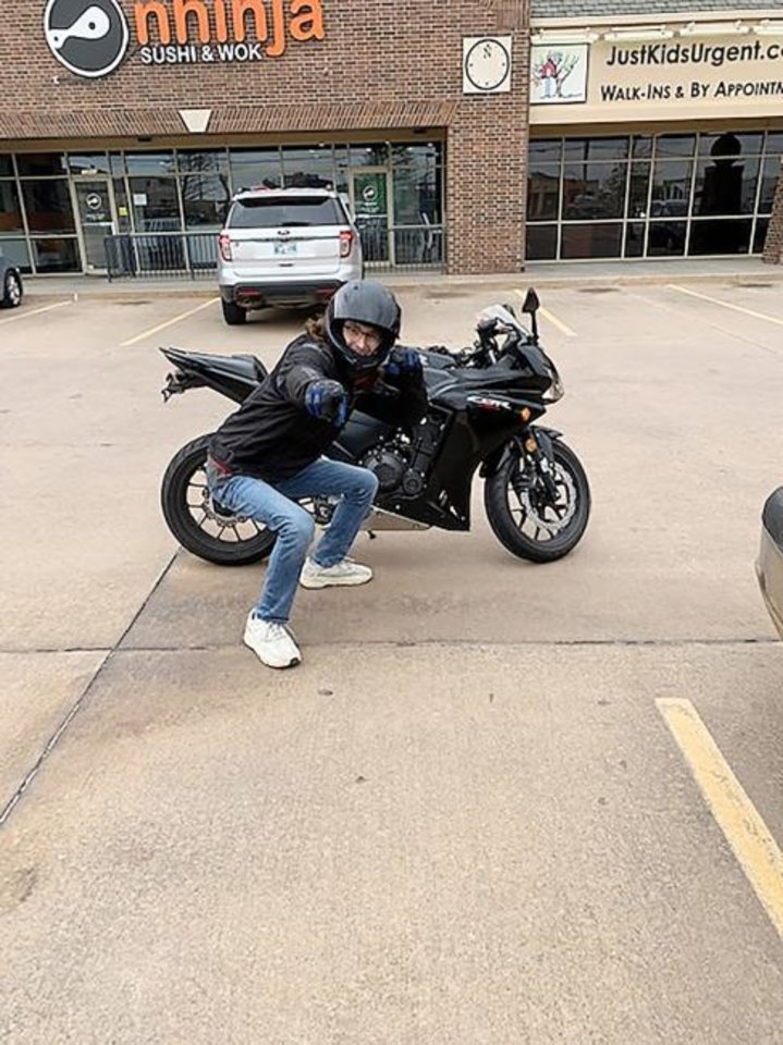 Photo -  Zach George of Midwest city lost his job in March and among other bills owes insurance on a new motorcycle he recently bought. [PHOTO PROVIDED]