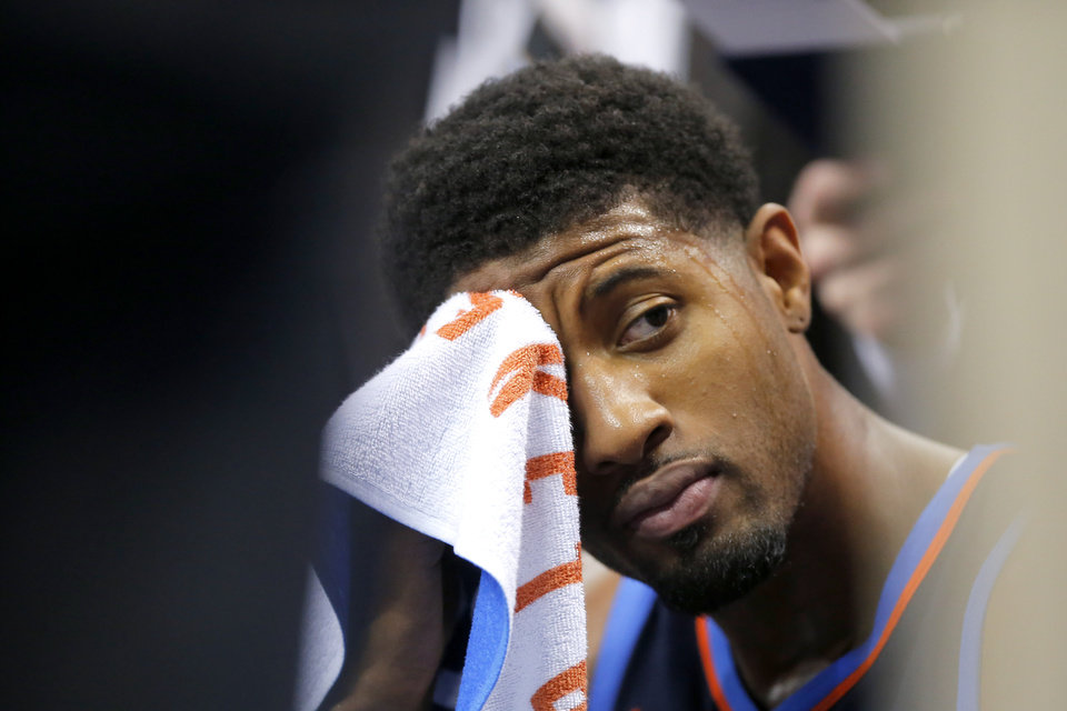 Photo - Oklahoma City's Paul George (13) wipes sweat off his face during a timeout in an NBA basketball game between the Oklahoma City Thunder and the Sacramento Kings at Chesapeake Energy Arena in Oklahoma City, Sunday, Oct. 21, 2018. Photo by Bryan Terry, The Oklahoman