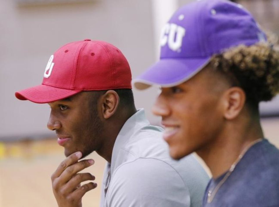 Photo -  McGuinness football players Brynden Walker, who committed to OU, and Dominic Richardson, TCU signee, sit together during National Signing Day. [Photo by Doug Hoke/The Oklahoman]