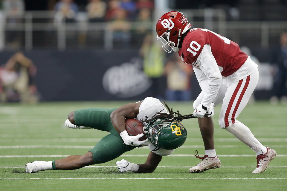 Photo - Oklahoma's Pat Fields (10) brings down Baylor's JaMycal Hasty (6) by his hair during the Big 12 Championship Game between the University of Oklahoma Sooners (OU) and the Baylor University Bears at AT&T Stadium in Arlington, Texas, Saturday, Dec. 7, 2019. Oklahoma won 30-23. [Bryan Terry/The Oklahoman]