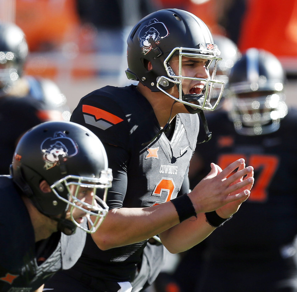 Photo - Oklahoma State's Mason Rudolph (2) warms up before the college football game between the Oklahoma State Cowboys (OSU) and TCU Horned Frogs at Boone Pickens Stadium in Stillwater, Okla., Saturday, Nov. 7, 2015. Photo by Nate Billings, The Oklahoman