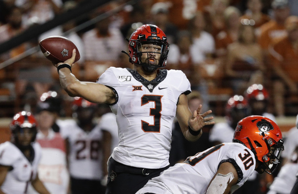 Photo - Oklahoma State quarterback Spencer Sanders (3) throws against Texas during the second half of an NCAA college football game Saturday, Sept. 21, 2019, in Austin, Texas. (AP Photo/Eric Gay)