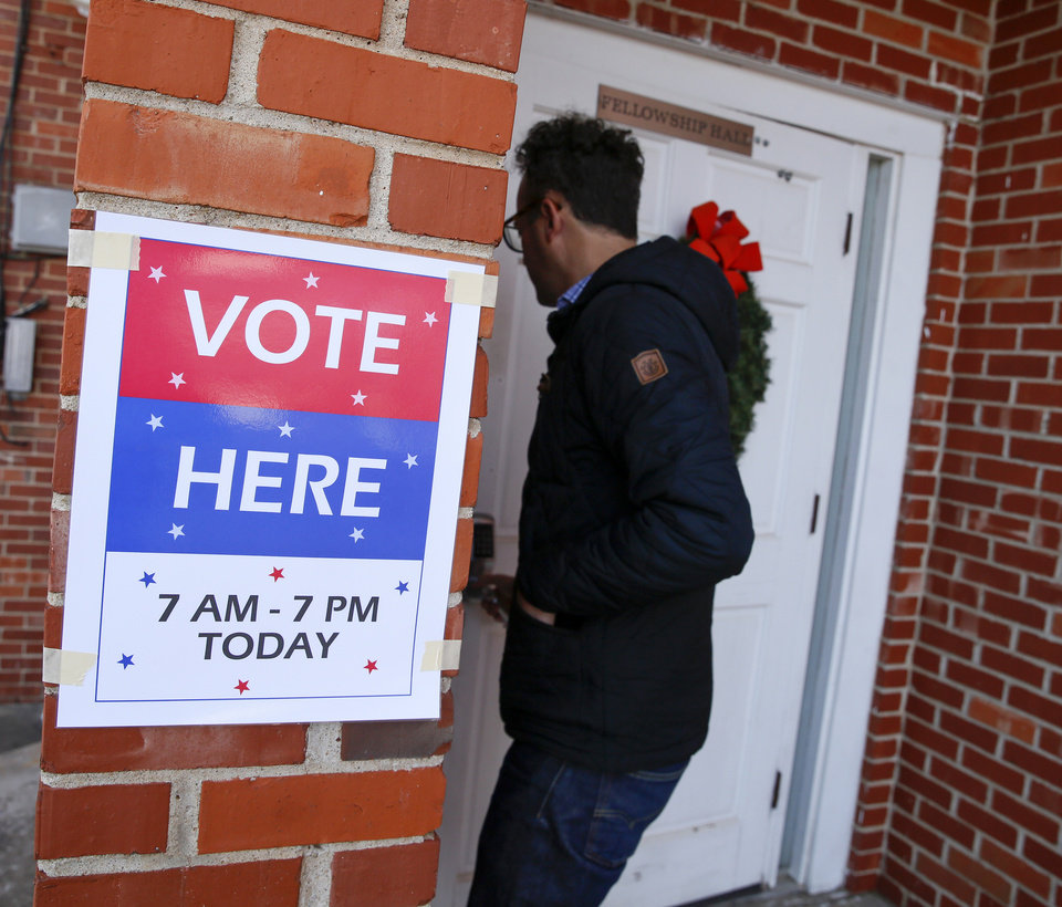 Photo - A man enters the polling place inside Central Presbyterian Church as residents vote on MAPS 4 in Oklahoma City, Tuesday, Dec. 10, 2019. [Nate Billings/The Oklahoman]