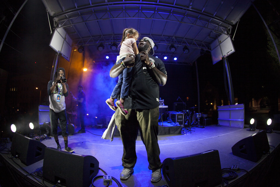 Photo -  Norman-based rapper Zie performs live at Norman Music Festival on the festival's first curated hip-hop stage. [Photo by Nathan Poppe, The Oklahoman]