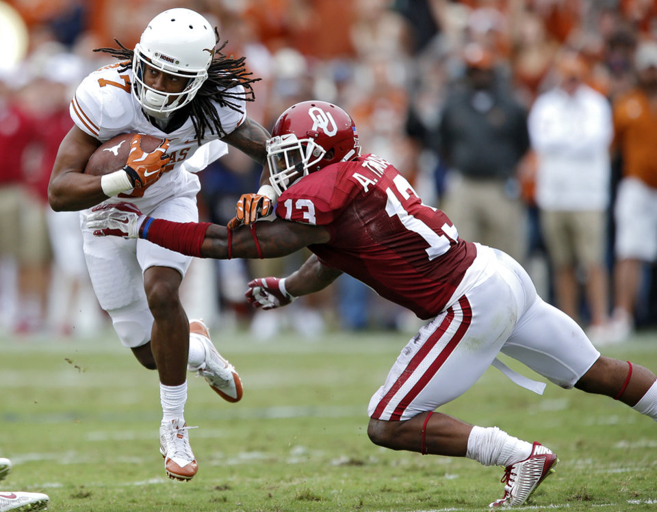 Photo - Texas' Marcus Johnson (7) runs past Oklahoma's Ahmad Thomas (13) during the college football game between the University of Oklahoma Sooners (OU) and the University of Texas Longhorns (UT) during the Red River Showdown at the Cotton bowl in Dallas, Texas on Saturday, Oct. 11, 2014. Photo by Chris Landsberger, The Oklahoman