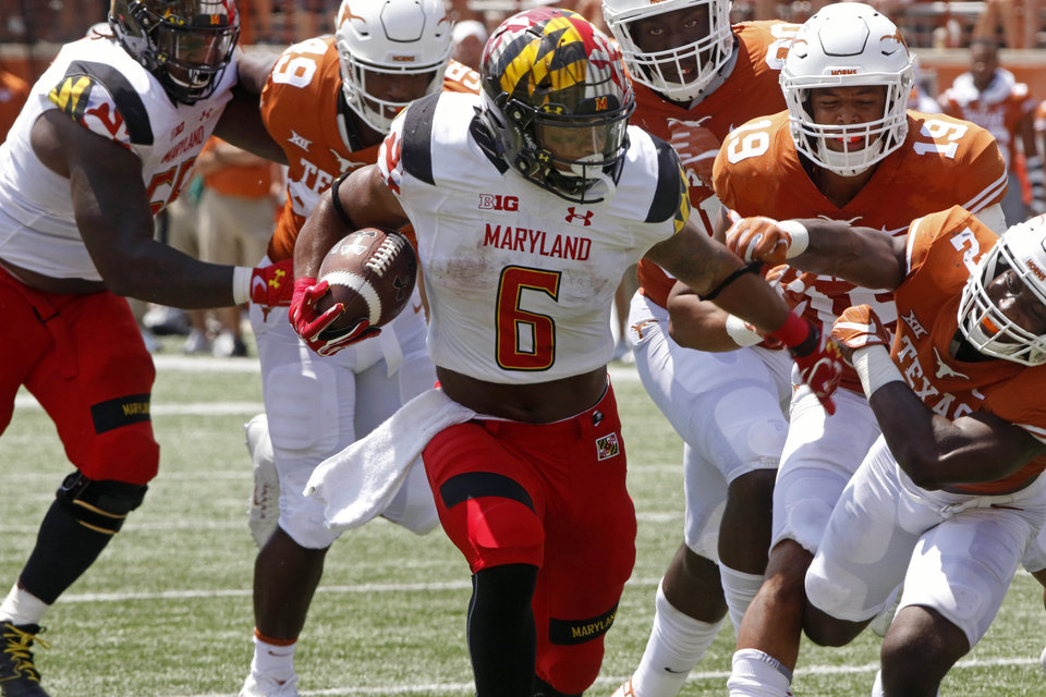Photo - Maryland running back Ty Johnson (6) rushes the ball against the Texas defense during the second half of an NCAA college football game, Saturday, Sept. 2, 2017, in Austin, Texas. Maryland won 51-41. (AP Photo/Michael Thomas)
