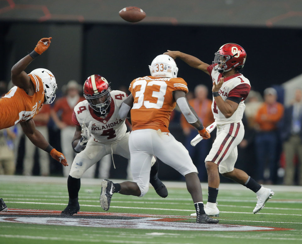 Photo - Oklahoma's Kyler Murray (1) throws a pass during the Big 12 Championship football game between the Oklahoma Sooners (OU) and the Texas Longhorns (UT) at AT&T Stadium in Arlington, Texas, Saturday, Dec. 1, 2018.  Oklahoma won 39-27. Photo by Bryan Terry, The Oklahoman