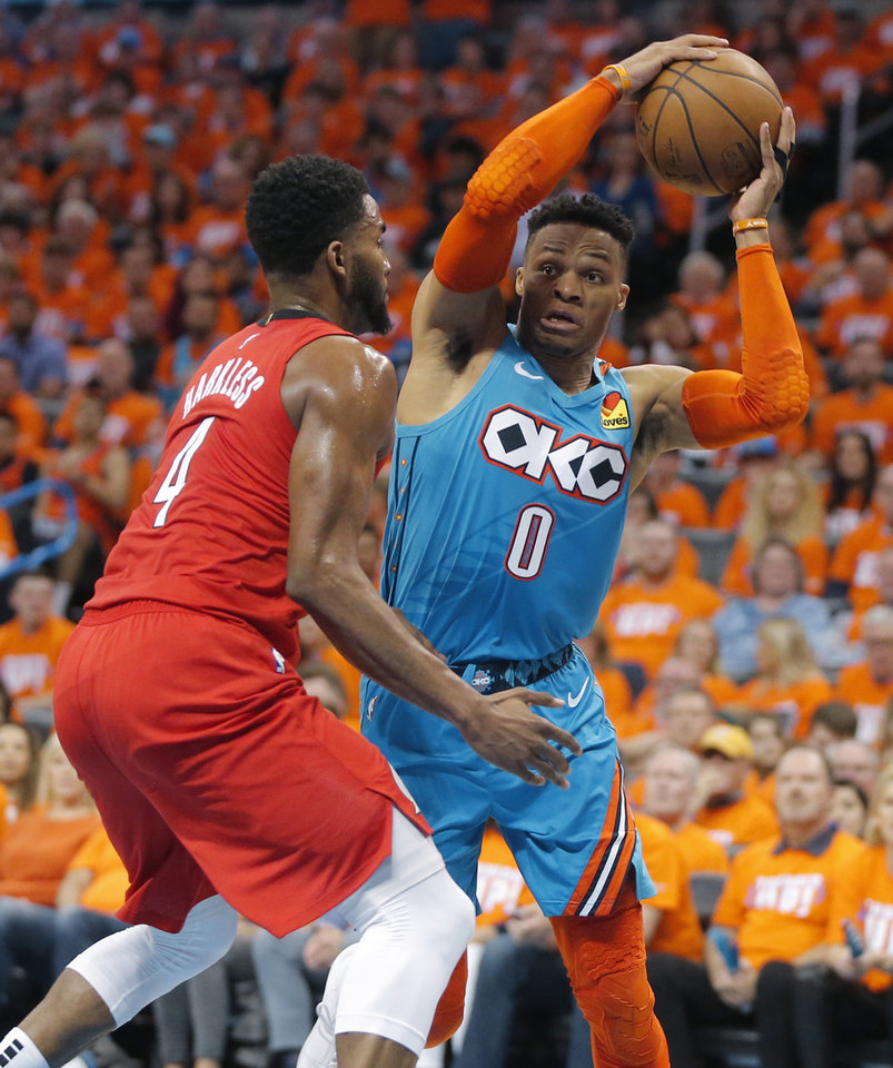 Photo - Oklahoma City's Russell Westbrook (0) tries to get past Portland's Maurice Harkless (4) during Game 3 in the first round of the NBA playoffs between the Portland Trail Blazers and the Oklahoma City Thunder at Chesapeake Energy Arena in Oklahoma City, Friday, April 19, 2019. Photo by Bryan Terry, The Oklahoman