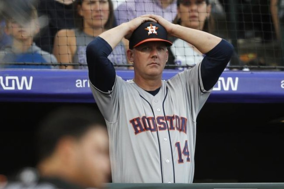 Photo -  Midwest City High School alum A.J. Hinch was fired by the Houston Astros on Monday after being suspended by Major League Baseball for one season for sign-stealing by the team in 2017 and 2018 season. [AP Photo/David Zalubowski, File]
