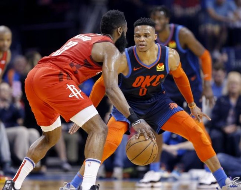 Photo -  Houston's James Harden looks to get past Oklahoma City's Russell Westbrook during Tuesday night's game at Chesapeake Energy Arena. The Thunder beat the Rockets, 112-111. [Sarah Phipps/The Oklahoman]