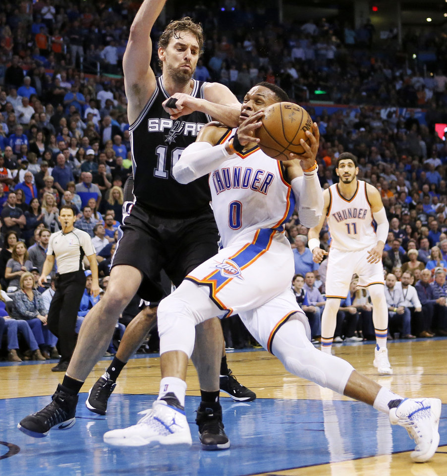 Photo - Oklahoma City's Russell Westbrook (0) drives against San Antonio's Pau Gasol (16) during an NBA basketball game between the Oklahoma City Thunder and San Antonio Spurs at Chesapeake Energy Arena in Oklahoma City, Friday, March 31, 2017. San Antonio won 100-95. Photo by Nate Billings, The Oklahoman