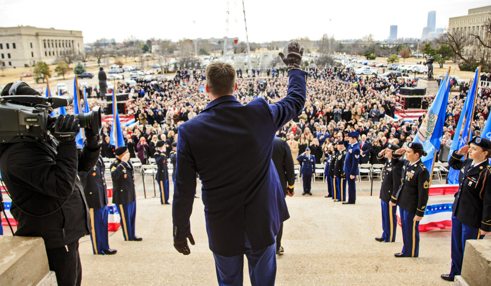 Photo - Gov. elect Kevin Stitt waves to the crowd as he walks down the south steps of the capitol for his inauguration ceremony at the Oklahoma State Capitol in Oklahoma City, Okla. on Monday, Jan. 14, 2019.  Photo by Chris Landsberger, The Oklahoman