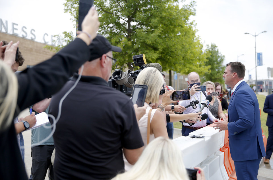 Photo - Gov. Kevin Stitt speaks to the media outside  the BOK before the Trump Rally in Tulsa, Okla., Saturday, June 20, 2020. [Sarah Phipps/The Oklahoman]