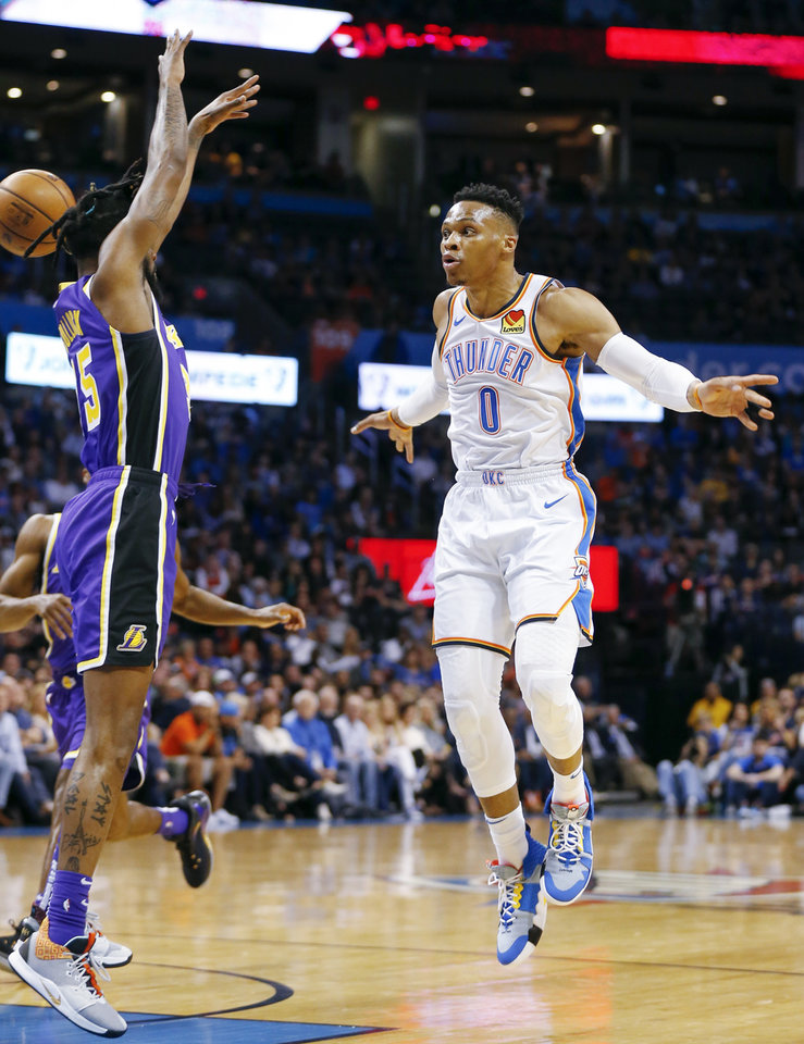 Photo - Oklahoma City's Russell Westbrook (0) passes around Los Angeles' Reggie Bullock (35) in the first quarter during an NBA basketball game between the Los Angeles Lakers and the Oklahoma City Thunder at Chesapeake Energy Arena in Oklahoma City, Tuesday, April 2, 2019. Photo by Nate Billings, The Oklahoman