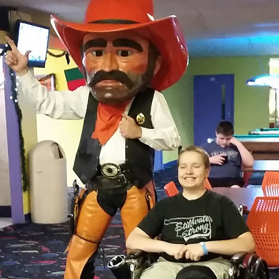 Photo -  Alleyn Campbell is pictured here with Pistol Pete during a bowling fundraiser in Campbell's honor. Campbell was injured on Oct. 24, 2015, during the crash at Oklahoma State University's homecoming parade. Taylor Collins, who serves as Oklahoma State University's mascot Pistol Pete, drove him to the hospital. [Photo provided]
