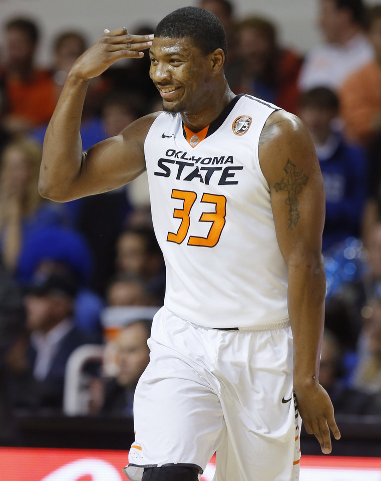 Photo - Oklahoma State's Marcus Smart (33) celebrates after a basket during an NCAA college basketball game between Oklahoma State and Memphis at Gallagher-Iba Arena in Stillwater, Okla., Tuesday, Nov. 19, 2013. Photo by Bryan Terry, The Oklahoman