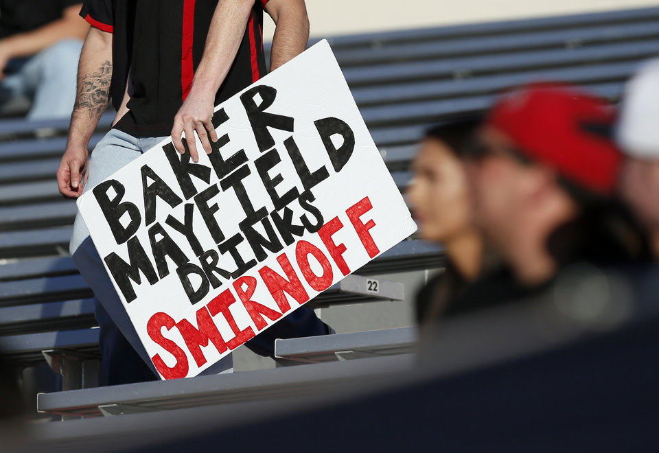 Photo - A Texas Tech fan holds a sign to taunt Baker Mayfield before a college football game between the University of Oklahoma Sooners and Texas Tech Red Raiders at Jones AT&T Stadium in Lubbock, Texas, Saturday, Oct. 22, 2016. Photo by Nate Billings, The Oklahoman