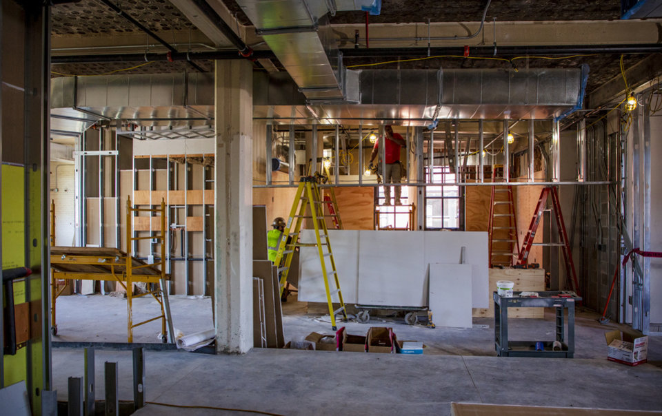 Photo - Crews continue construction on Parlor OKC, a new food hall that opens this summer, located at 11 NE 6th St. in downtown Oklahoma City, Okla. on Thursday, May 30, 2019. [Chris Landsberger/The Oklahoman]