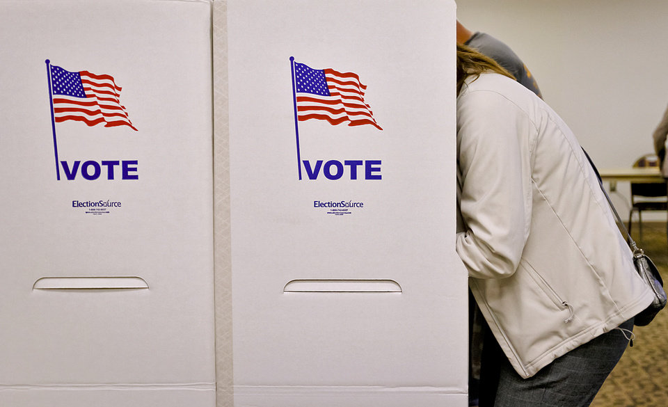 Photo - A voter fills out a ballot during election day on Tuesday, Nov. 6, 2012, in Yukon, Oklahoma. Photo by Chris Landsberger, The Oklahoman