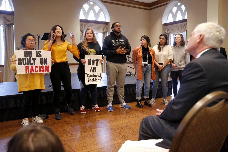 Photo - University of Oklahoma President James Gallogly, right, listens as students speak  during a Rally to Stop Racism, hosted by the Black Student Association, on the campus of the University of Oklahoma, Tuesday, Jan. 22, 2019. The rally was in response to a video that surfaced on social media of an OU student in blackface. Photo by Bryan Terry, The Oklahoman