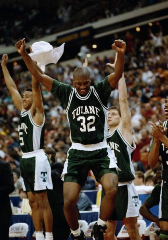 Photo -  Carlin Hartman, center celebrate's Tulane's NCAA Tournament victory in 1992. Hartman is now an assistant coach at OU following a winding journey as an assistant coach. [AP Photo/David Martin]