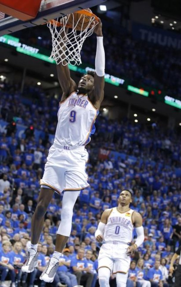 Photo -  Oklahoma City's Jerami Grant dunks the ball during Game 4 on Sunday in the first round of a Western Conference playoff series vs. Portland. OKC trails the series 3-1 after the Trail Blazers' 111-98 victory at Chesapeake Energy Arena. [Sarah Phipps/The Oklahoman]