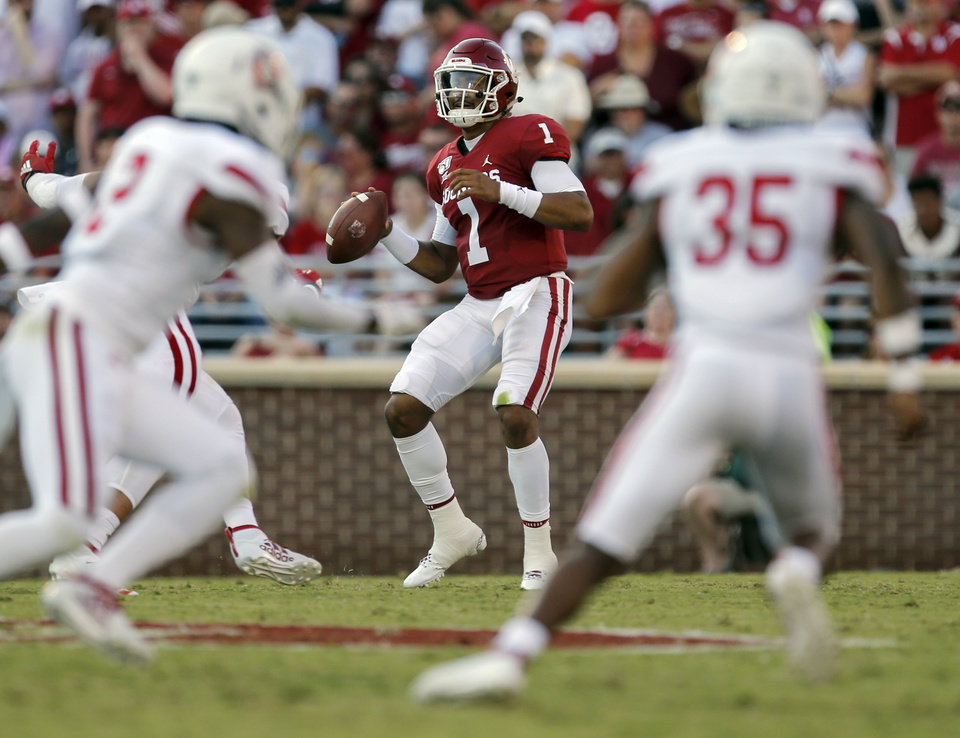 Photo - Oklahoma's Jalen Hurts (1) looks to pass in the first quarter during a college football game between the Oklahoma Sooners (OU) and South Dakota Coyotes at Gaylord Family - Oklahoma Memorial Stadium in Norman, Okla., Saturday, Sept. 7, 2019. [Nate Billings/The Oklahoman]