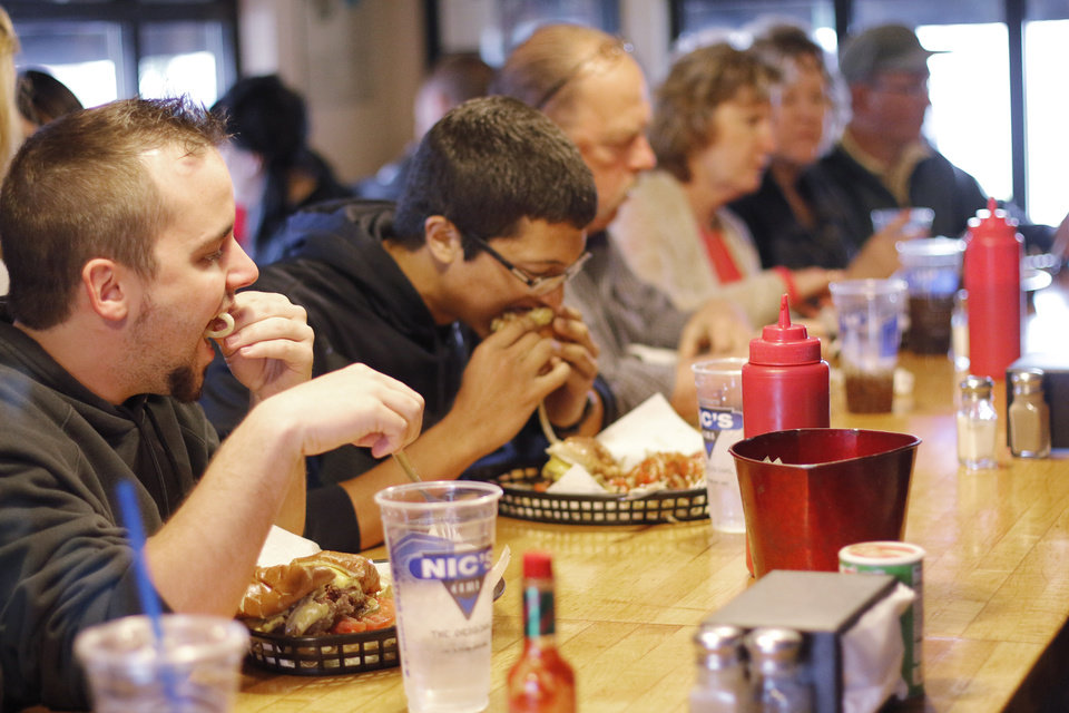 Photo - Customers at the counter at Nic's Grill, Friday, March 27, 2015. Photo by Doug Hoke, The Oklahoman