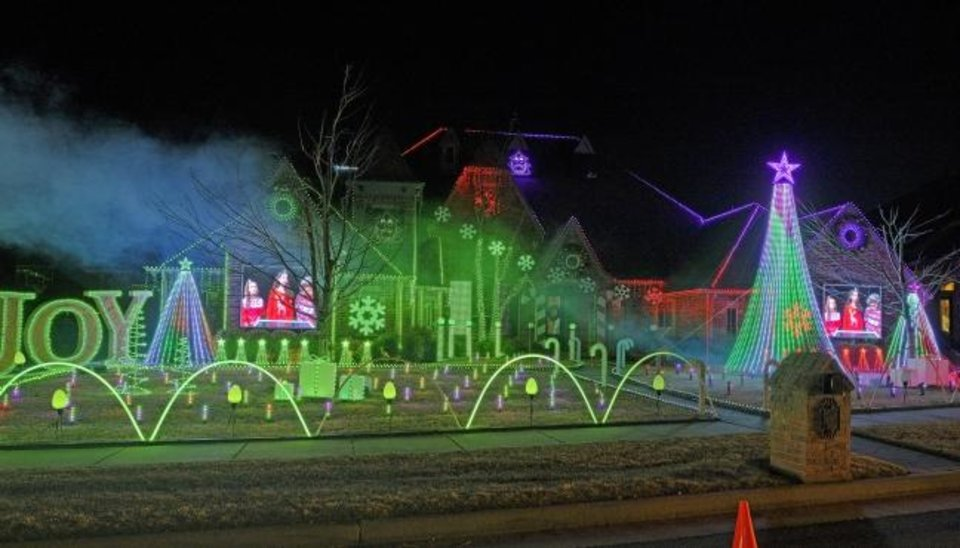 Photo -  Miranda Family Lights, 19544 Talavera Lane in Edmond, is a light show synchronized with music. Donations collected for the Regional Food Bank. [DOUG HOKE/THE OKLAHOMAN]