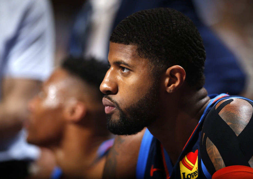 Photo - Oklahoma City's Paul George (13) sits on the bench during a time out during the NBA basketball game between the Oklahoma City Thunder and the Golden State Warriors at Chesapeake Energy Arena,  Saturday, March 16, 2019. Photo by Sarah Phipps, The Oklahoman