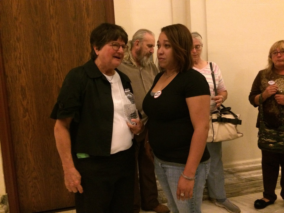 Photo -  Anti-death penalty activist and author Sister Helen Prejean, left, speaks Monday to Erika Glossip-Hodge, daughter of Richard Glossip, at the state Capitol. He is set to die Wednesday. [Photo by Graham Lee Brewer, The Oklahoman]