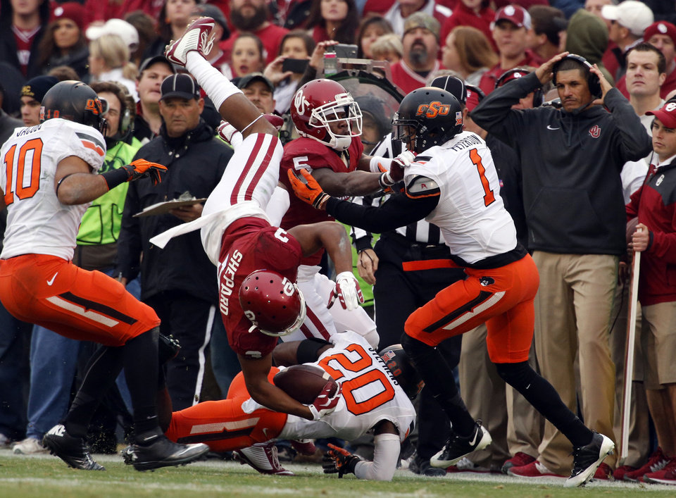 Photo - Sooner's Sterling Shepard (3) catches a pass and leaves the field in the first half during a Bedlam college football game between the University of Oklahoma Sooners (OU) and the Oklahoma State Cowboys (OSU) at Gaylord Family-Oklahoma Memorial Stadium in Norman, Okla., on Saturday, Dec. 6, 2014. Photo by Steve Sisney, The Oklahoman