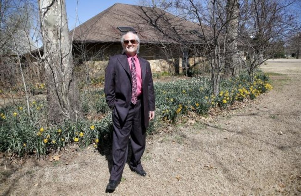 Photo -  Christopher Michael, who received the 2018 Rising Star Award from the Oklahoma City Metro Association of Realtors, stands in front of a garden at a house he has listed for sale at 107 Deer Creek Road. [SARAH PHIPPS/THE OKLAHOMAN]