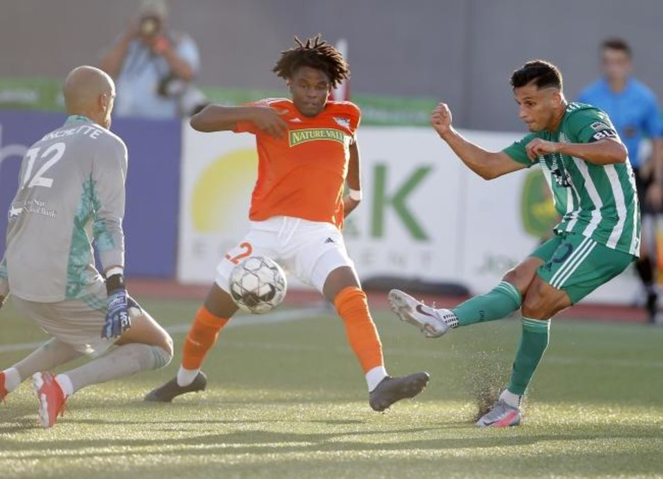 Photo -  Energy FC's Arun Basuljevic misses a shot as Rio Grande Valley FC's Paul Blanchette, left, and Kembo Kibato defend during 1-1 draw Wednesday at Taft Stadium. [Bryan Terry/The Oklahoman]
