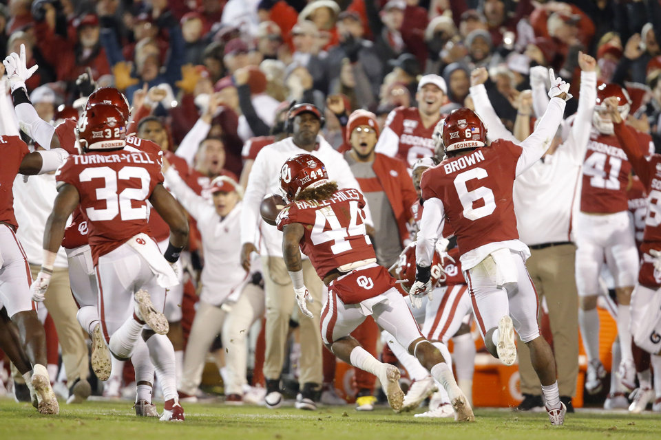 Photo - Oklahoma's Brendan Radley-Hiles (44) celebrtes after an interception during an NCAA football game between the University of Oklahoma Sooners (OU) and the TCU Horned Frogs at Gaylord Family-Oklahoma Memorial Stadium in Norman, Okla., Saturday, Nov. 23, 2019. Oklahoma won 28-24. [Bryan Terry/The Oklahoman]