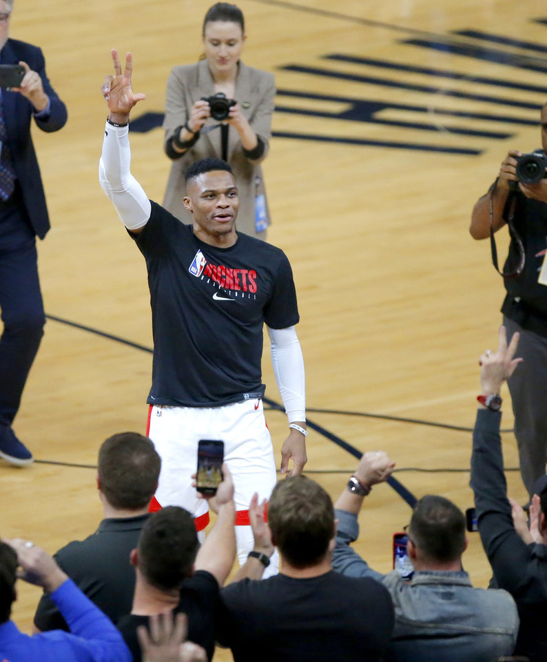 Photo - Houston's Russell Westbrook (0) shouts toward the crowd during introductions before an NBA basketball game between the Oklahoma City Thunder and Houston Rockets at Chesapeake Energy Arena in Oklahoma City, Thursday, Jan. 9, 2020. [Bryan Terry/The Oklahoman]