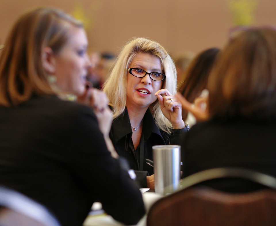 Photo -  Jeanne Neugebauer, with BigWing Interactive, shares ideas during a group discussion among participants at each table. Women in Leadership Conference at the Cox Convention Center on Wednesday. [Photo by Jim Beckel, The Oklahoman.]