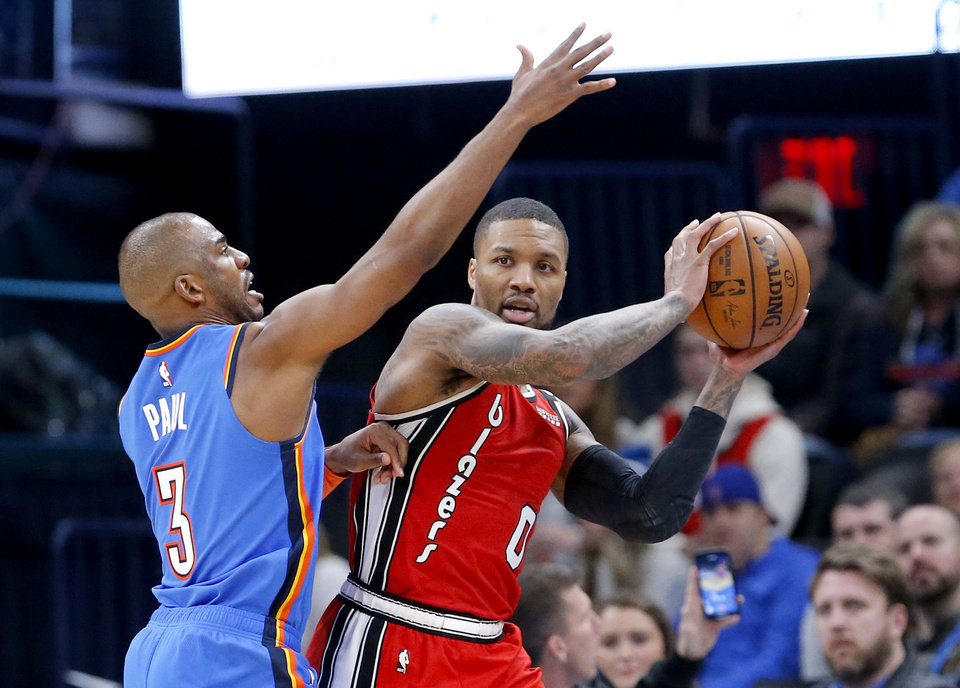 Photo - Oklahoma City's Chris Paul (3) defends against Portland's Damian Lillard (0) during the NBA basketball game between the Oklahoma City Thunder and the Portland Trail Blazers at the Chesapeake Energy Arena in Oklahoma City, Saturday, Jan. 18, 2020.  [Sarah Phipps/The Oklahoman]