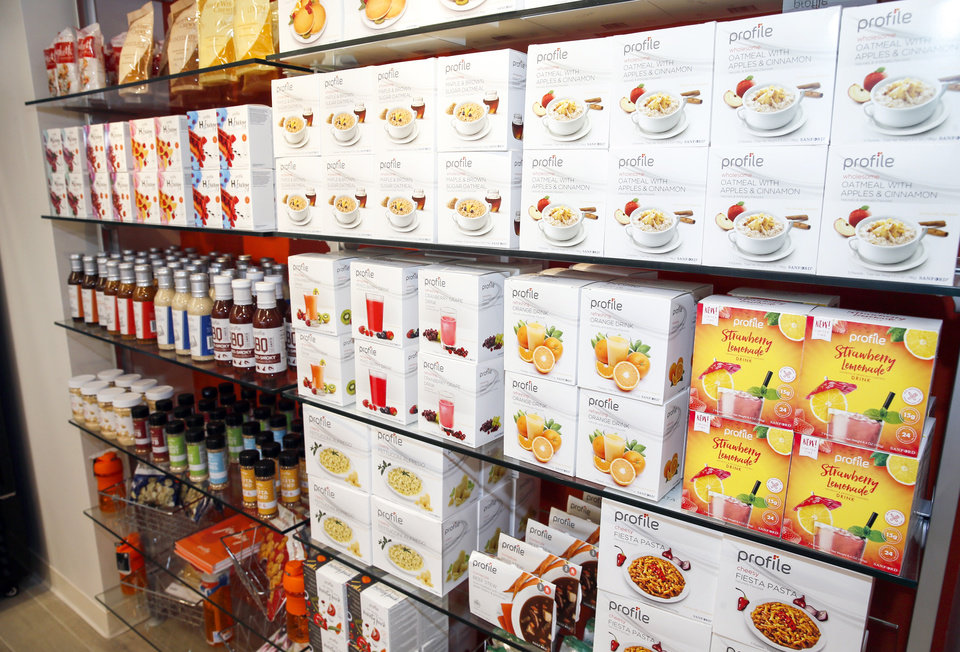 Photo -  Food and other products for sale line the walls at Profile Sanford in Oklahoma City. [NATE BILLINGS/THE OKLAHOMAN]