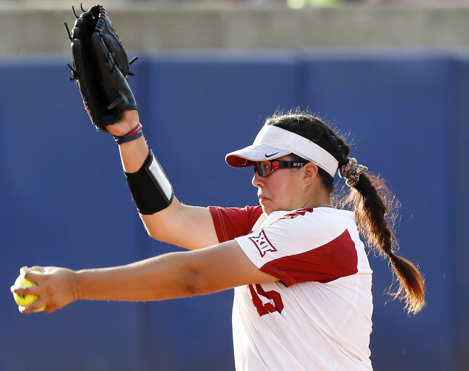 Photo - OU's Gisselle Juarez (45) pitches during the first NCAA softball game in the championship series of the Women's College World Series between Oklahoma and UCLA at USA Softball Hall of Fame Stadium in Oklahoma City, Monday, June 3, 2019. [Nate Billings/The Oklahoman]