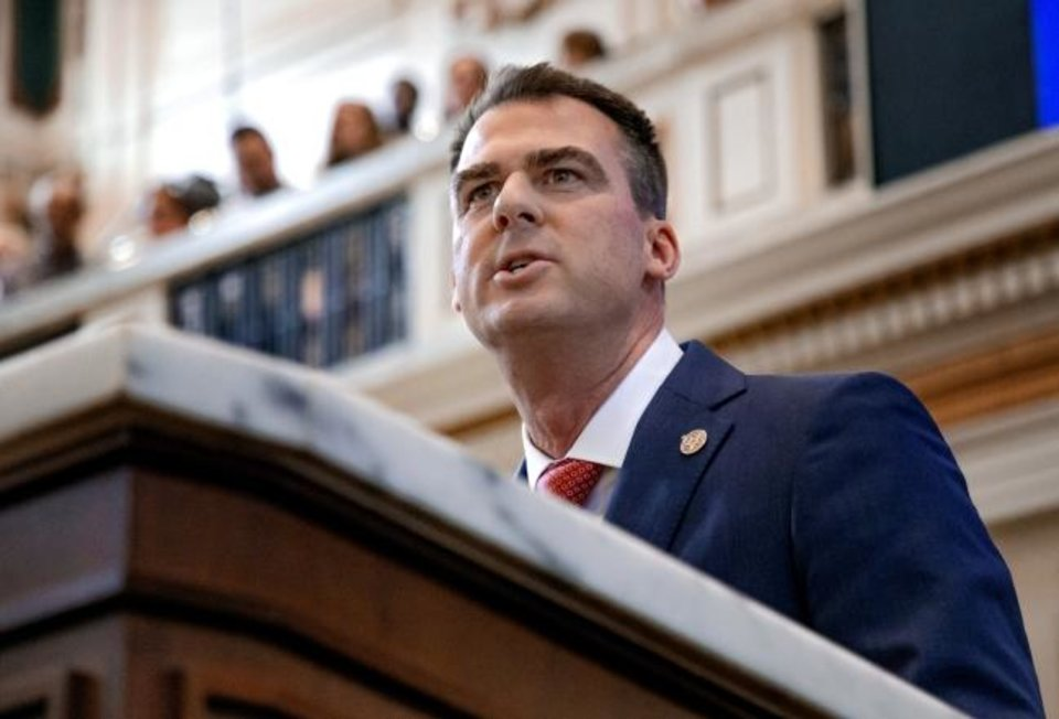 Photo -  Gov. Kevin Stitt delivers his State of the State Address in the House Chambers of the Oklahoma House of Representative in Oklahoma City, Okla. on Monday, Feb. 3, 2020.  [Chris Landsberger/The Oklahoman]