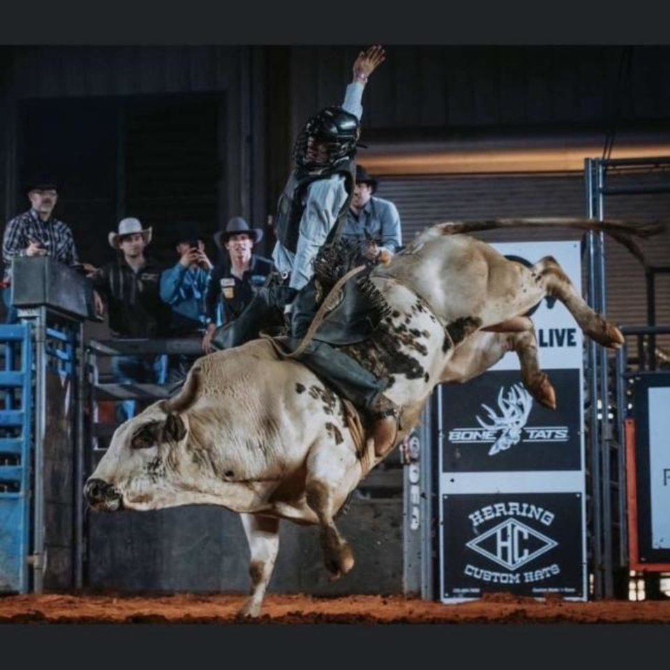 Photo -  Caden Bunch rides the L.J. Jenkins bucking bull JC's Gangster at a bull riding in Mississippi. [PHOTO PROVIDED]