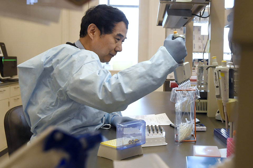 Photo -  In this Monday, March 2, 2020, file photo, microbiologist Xiugen Zhang runs a Polymerase Chain Reaction, or PCR, test at the Connecticut State Public Health Laboratory, in Rocky Hill, Conn. [AP Photo/Jessica Hill, File]