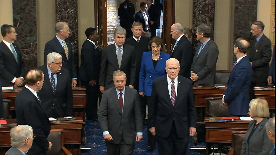 Photo -  In this image from video, Sen. Lindsey Graham, R-S.C., left, Sen. Patrick Leahy, D-Vt., Sen. Dianne Feinstein, D-Calif., and Sen. Roy Blunt, R-Mo., escort Supreme Court Chief Justice John Roberts into the Senate chamber in the Senate at the U.S. Capitol in Washington, Thursday, Jan. 16, 2020. (Senate Television via AP)