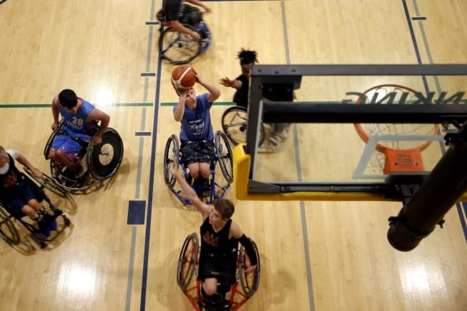 Photo -  Joshua, Gellenbeck, 14, of Bridge Creek, attempts a shot while playing wheelchair basketball during the Endeavor Games on Friday in Edmond. [Bryan Terry/The Oklahoman]